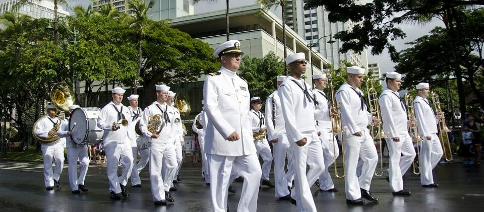 111218-N-RI884-097 HONOLULU (Dec. 18, 2011) The U.S. Pacific Fleet Marching Band participates in a parade through downtown Waikiki honoring Japanese-American veterans of World War II who recently received the Congressional Gold Medal. The medal was presented to members of the 442nd Regimental Combat Team, 100th Infantry Battalion, Military Intelligence Service and the 1399th Engineer Construction Battalion. (U.S. Navy photo by Mass Communication Specialist 2nd Class Daniel Barker/Released)