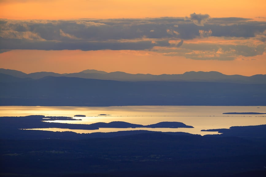 Sunset over Lake Champlain and the Adirondacks of New York from the top of Mt. Mansfield Vermont, USA
